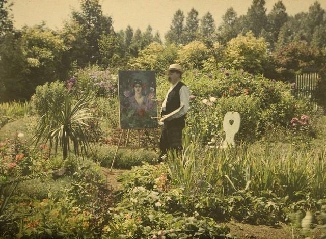 Van Besten pintando em seu jardim, 1912