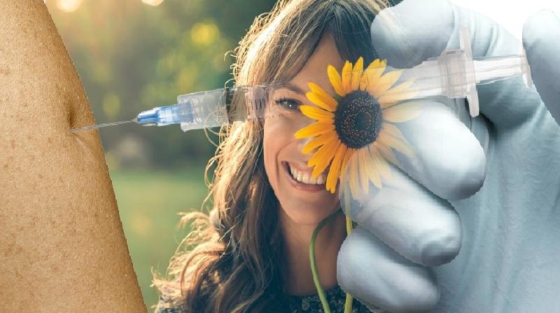 Um sorriso pode reduzir a dor de uma injeção?