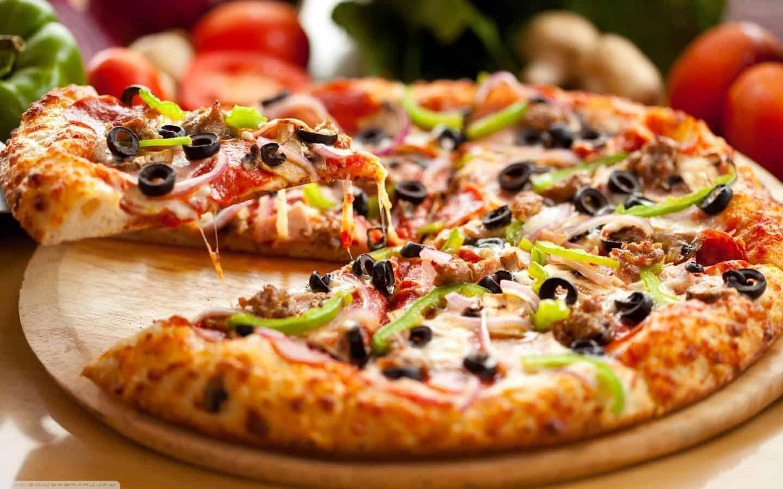 Pizza Tradicional - Foto 1